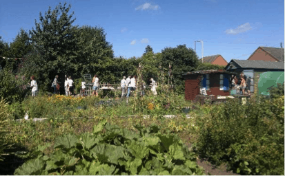 View of Syston allotment openday with visitors.